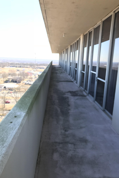 Multi-unit balcony before Performance Softwash Cleaning